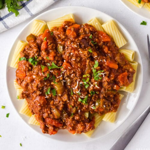 plate of bolognese sauce on pasta