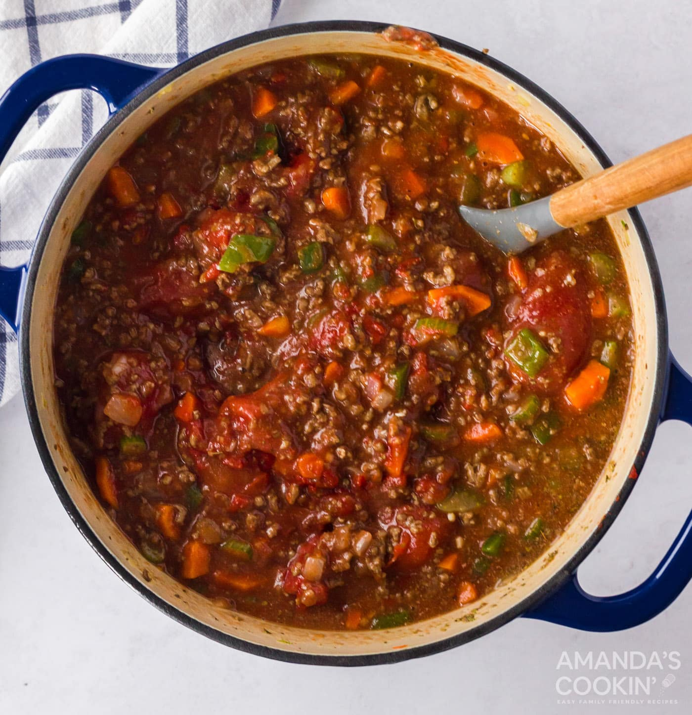 simmering pot of bolognese sauce