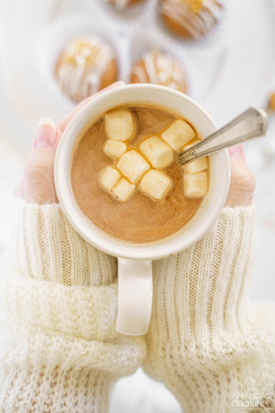 woman holding mug of hot cocoa