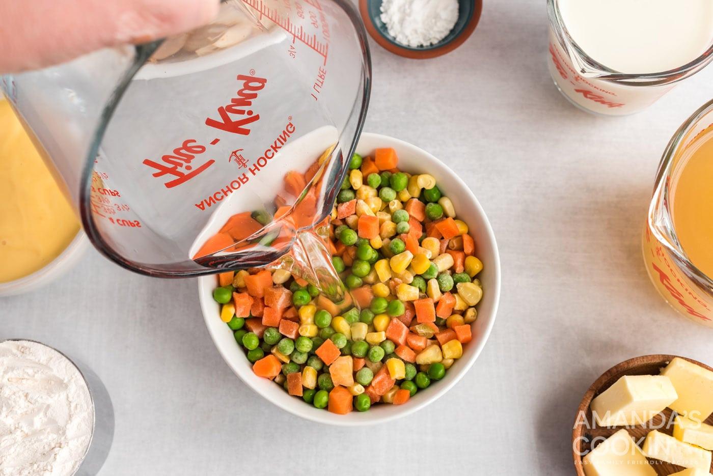 adding hot water to frozen veggies