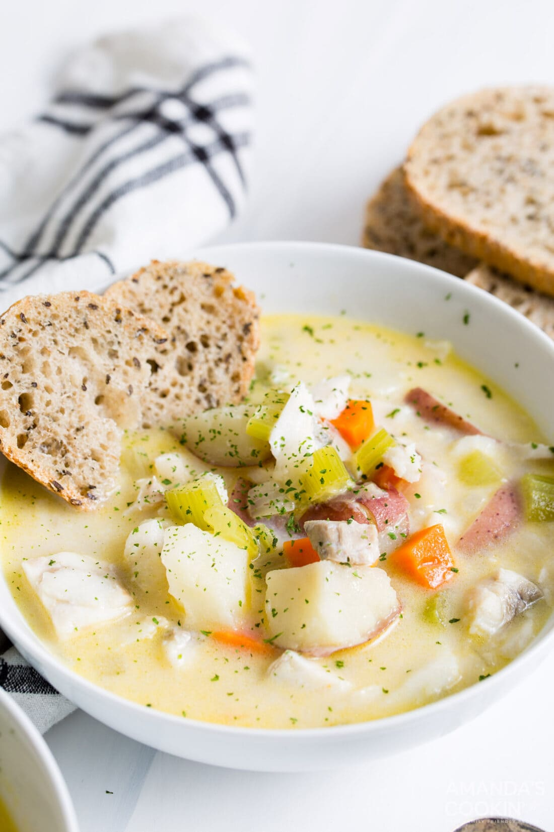 bowl of fish chowder with side of bread