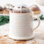 pouring milk over a hot cocoa bomb