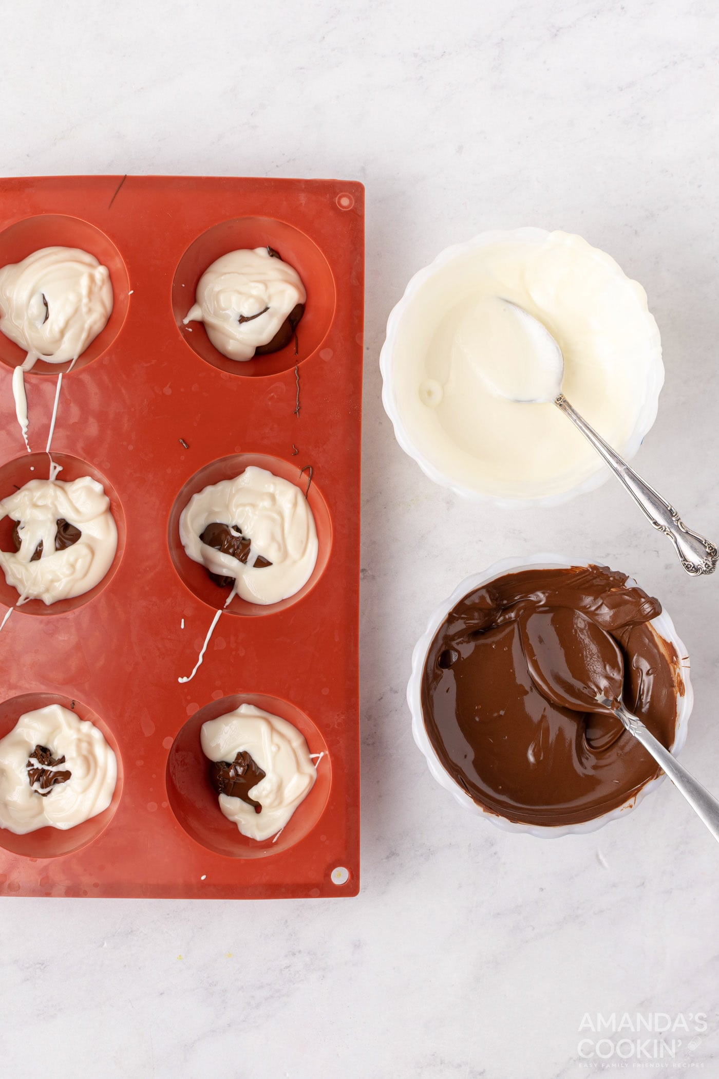adding chocolate to cocoa bomb molds
