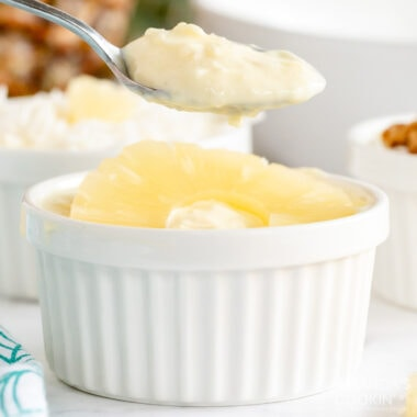 spoon lifting some pineapple yogurt dessert