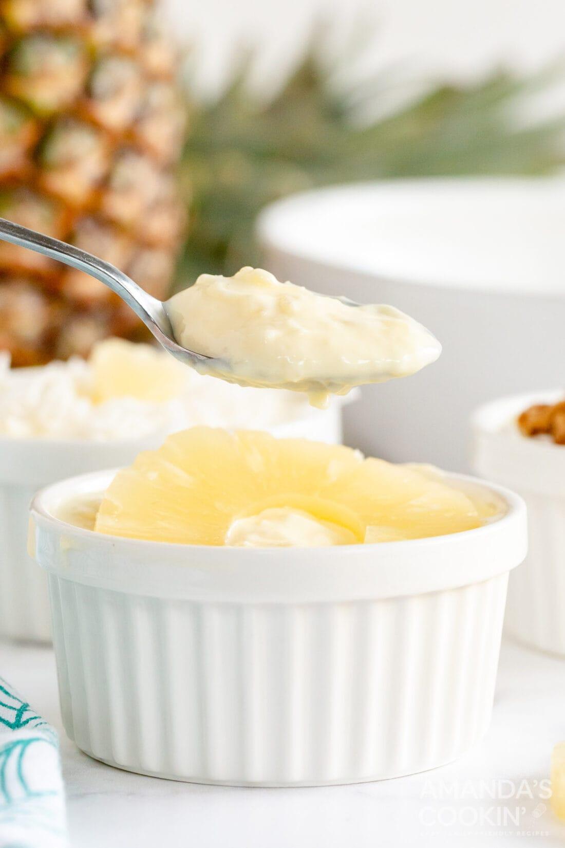 lifting spoon from pineapple yogurt dessert