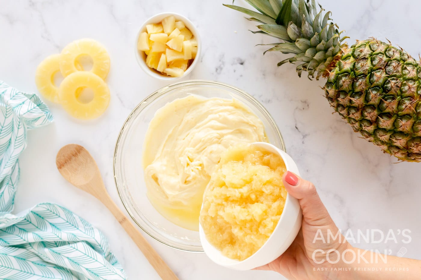 adding pineapple to bowl