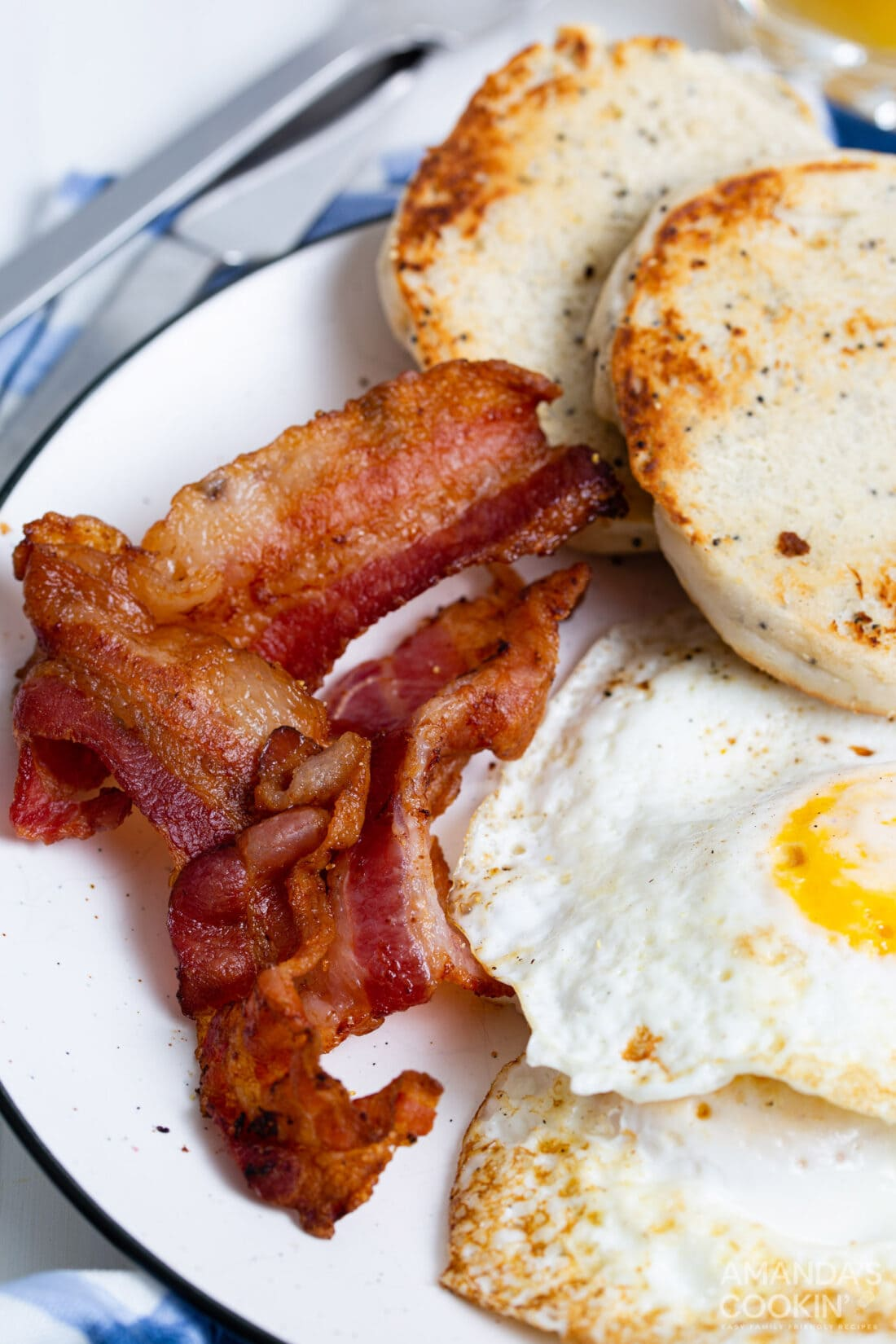 bacon on plate with eggs