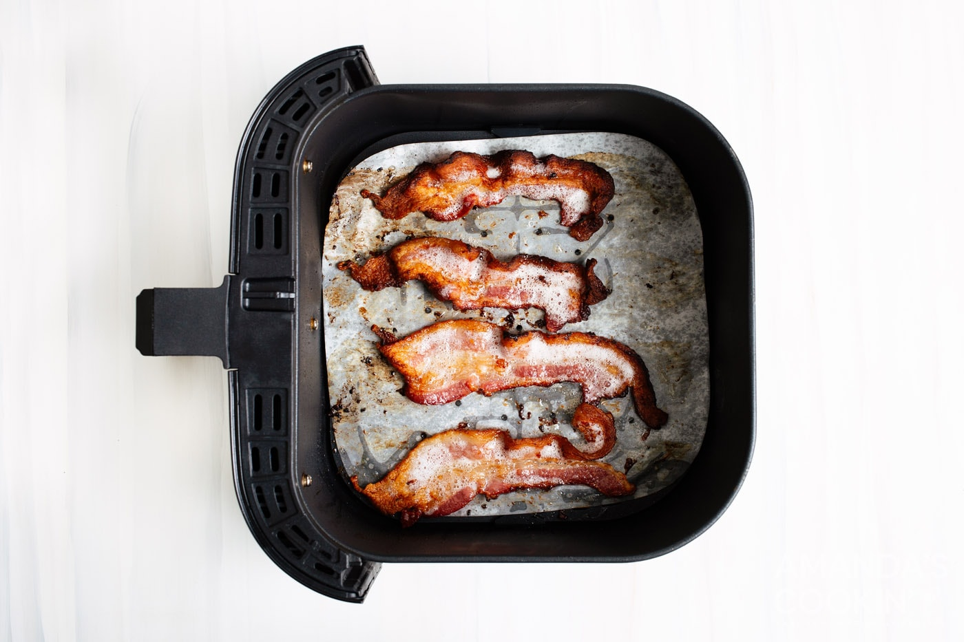 cooked bacon in air fryer basket