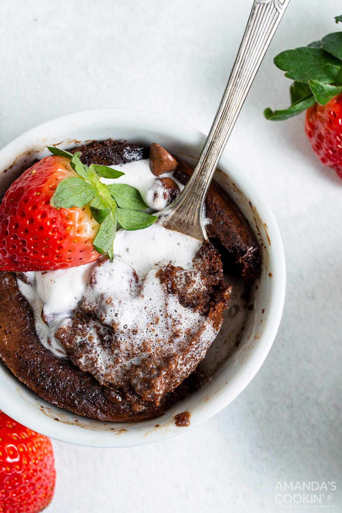 air fryer brownie in a ramekin with ice cream and strawberries