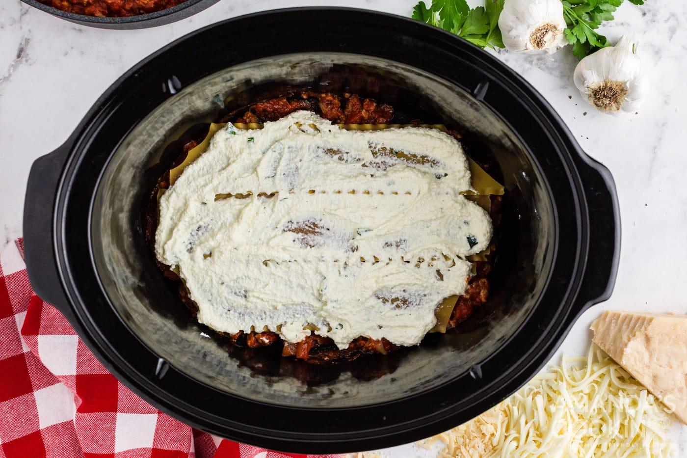 ricotta mixture on top of lasagna noodles