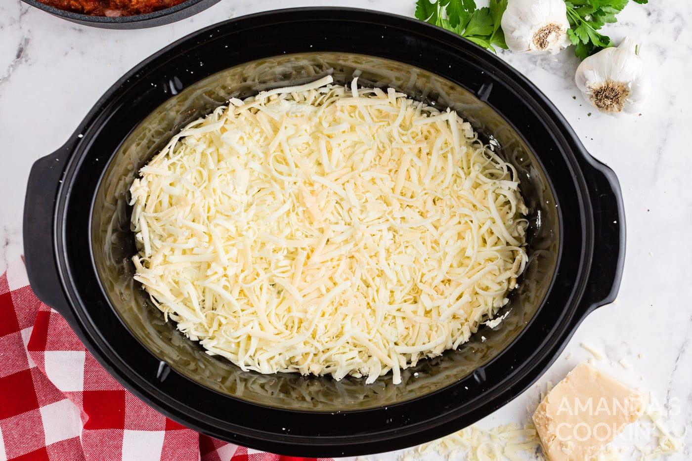 layer of mozzarella cheese in crockpot