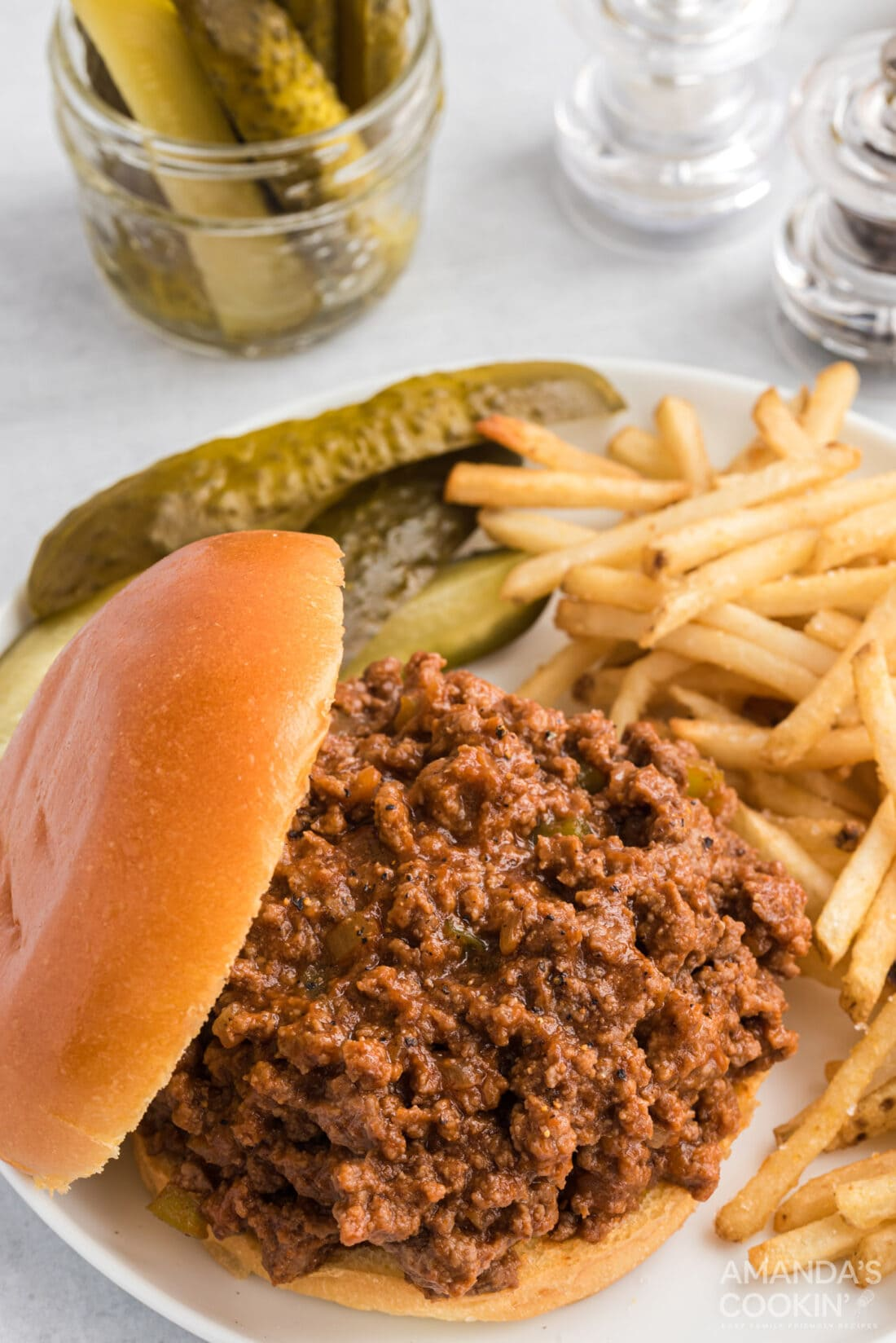 sloppy joes on a bun with fries