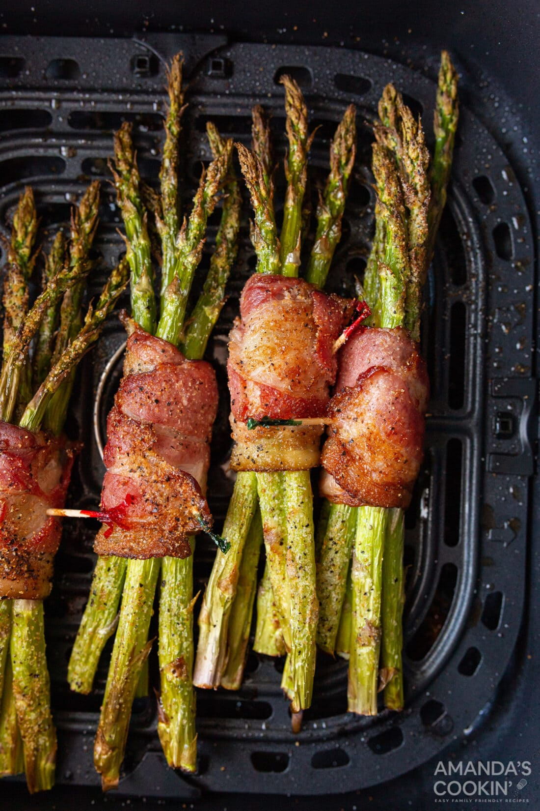 Bacon Wrapped Asparagus in an air fryer basket