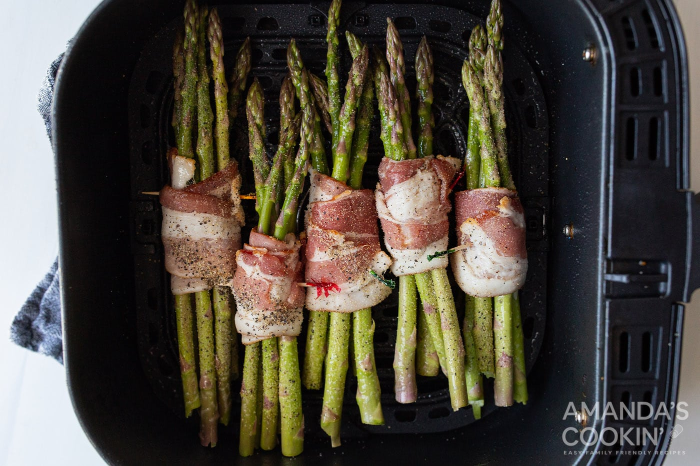 bacon wrapped asparagus in air fryer basket