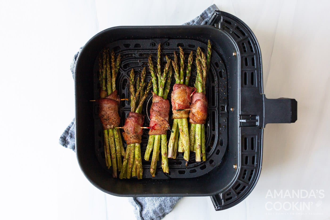 cooked air fryer bacon wrapped asparagus