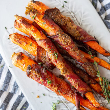 candied bacon wrapped carrots on a plate