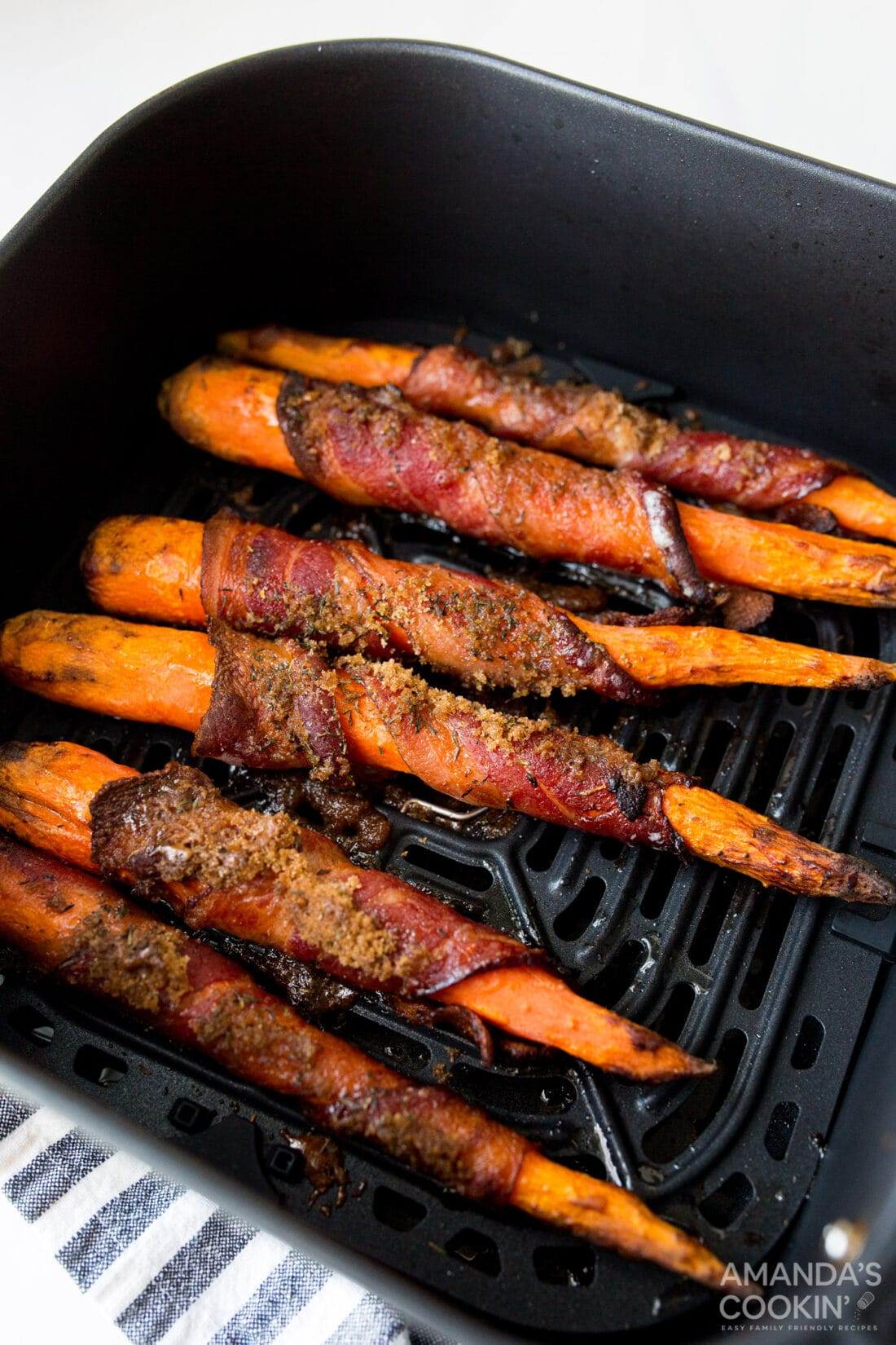 bacon wrapped carrots in the air fryer basket