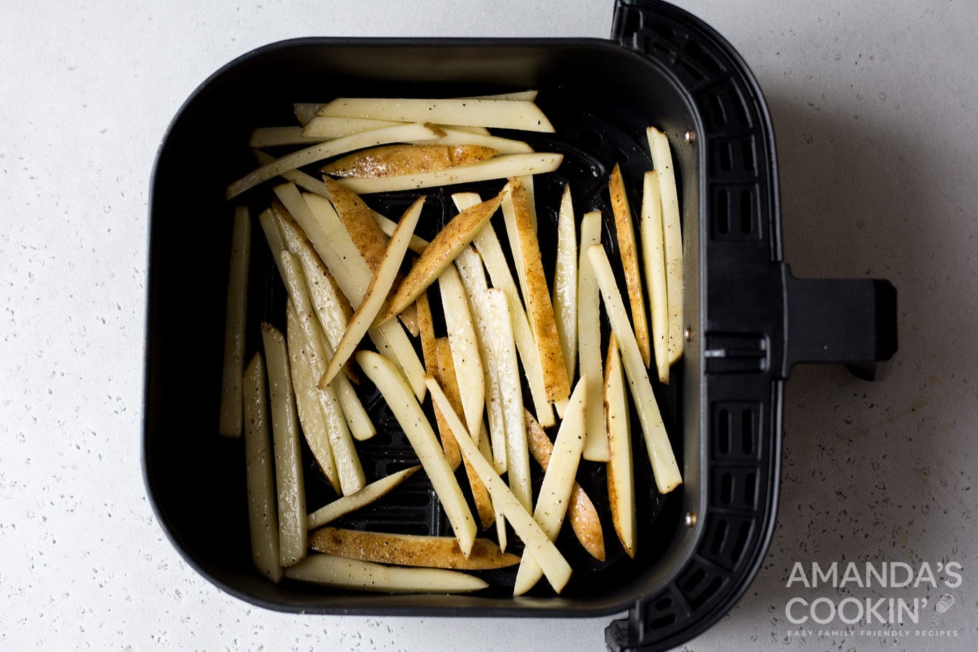 potato slices in air fryer basket