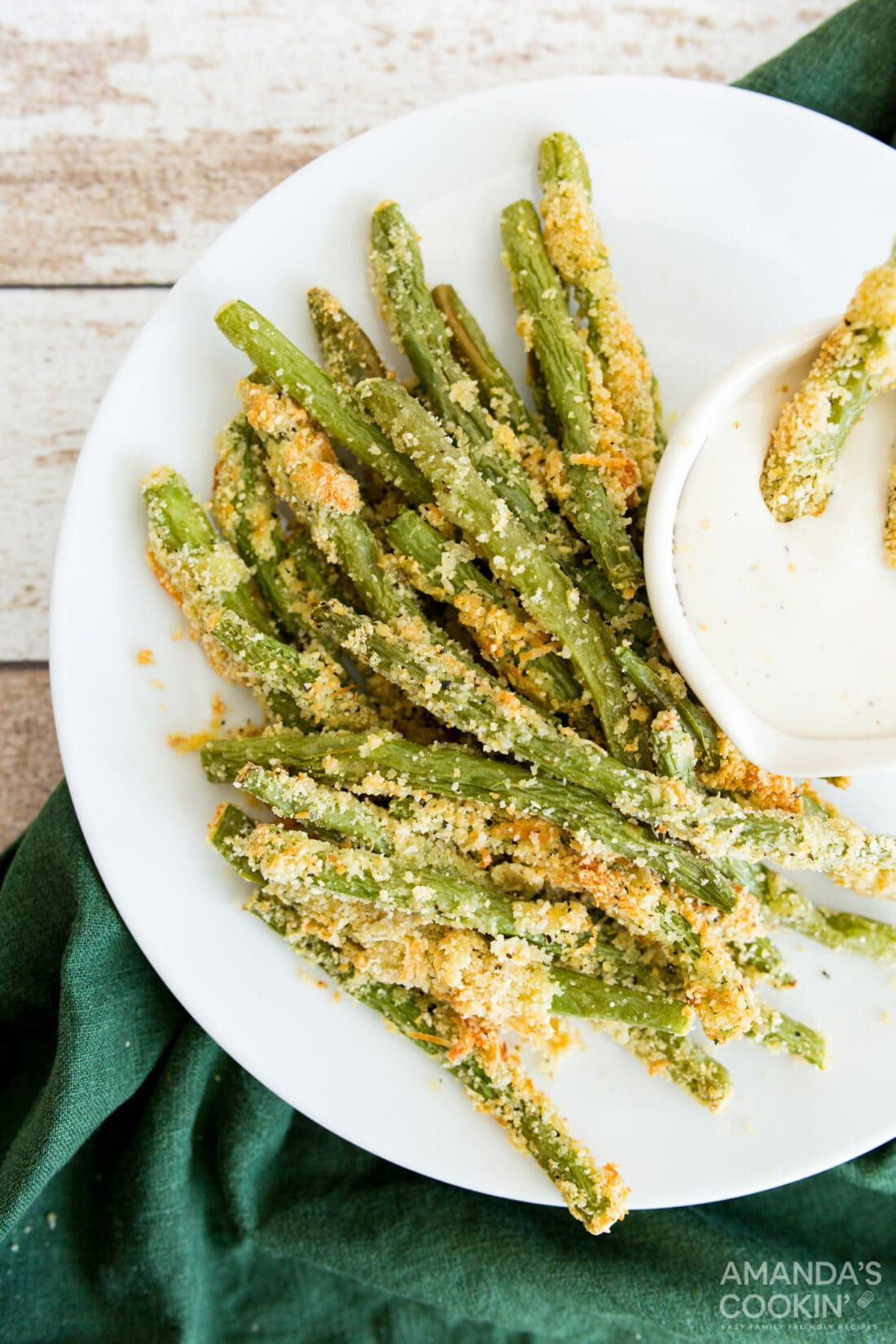 Air Fryer Green Bean Fries on a plate with dip