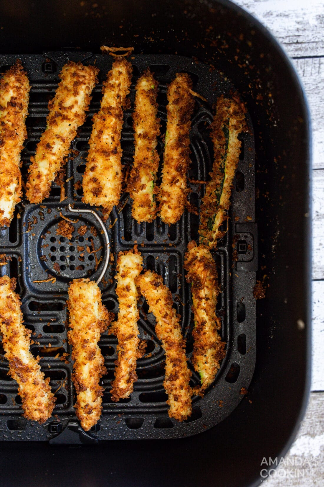 air fryer zucchini fries in an air fryer basket