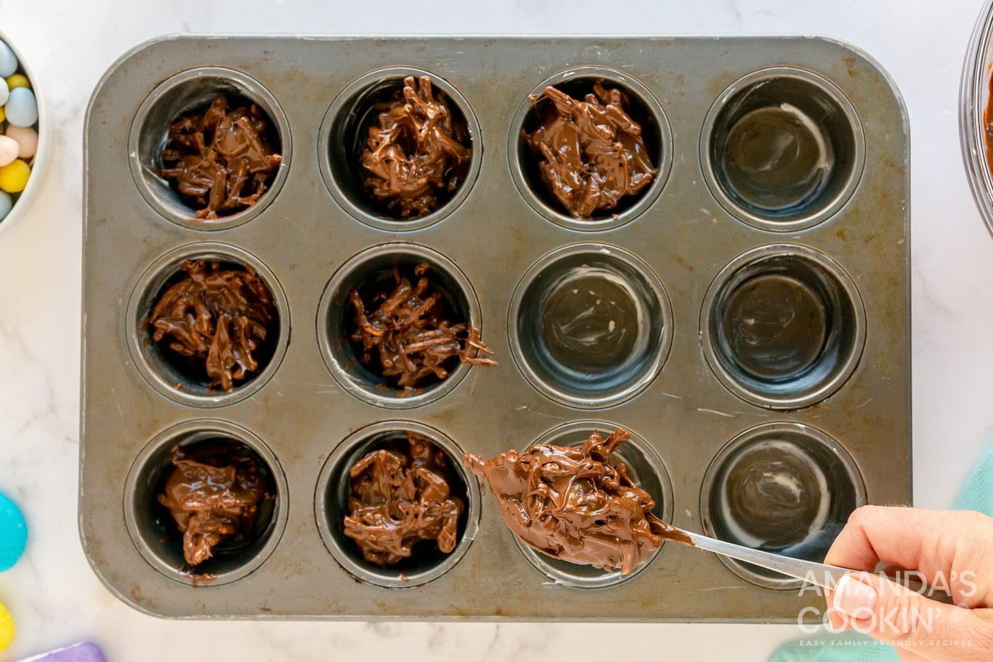 spooning bird nest cookie mixture into muffin pan