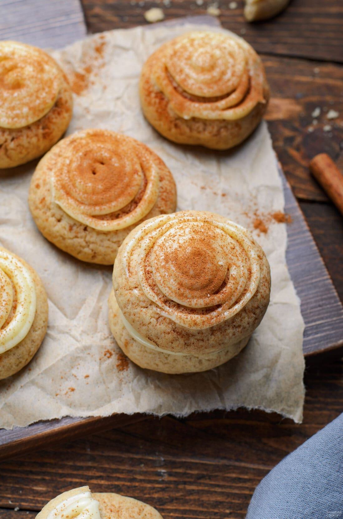 cinnamon roll cookies on parchment