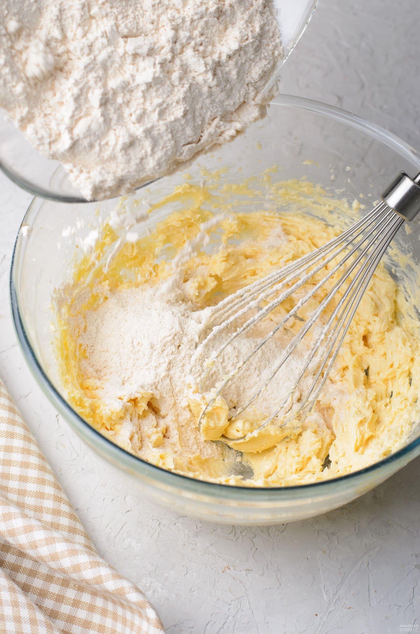 adding dry ingredients to wet ingredients