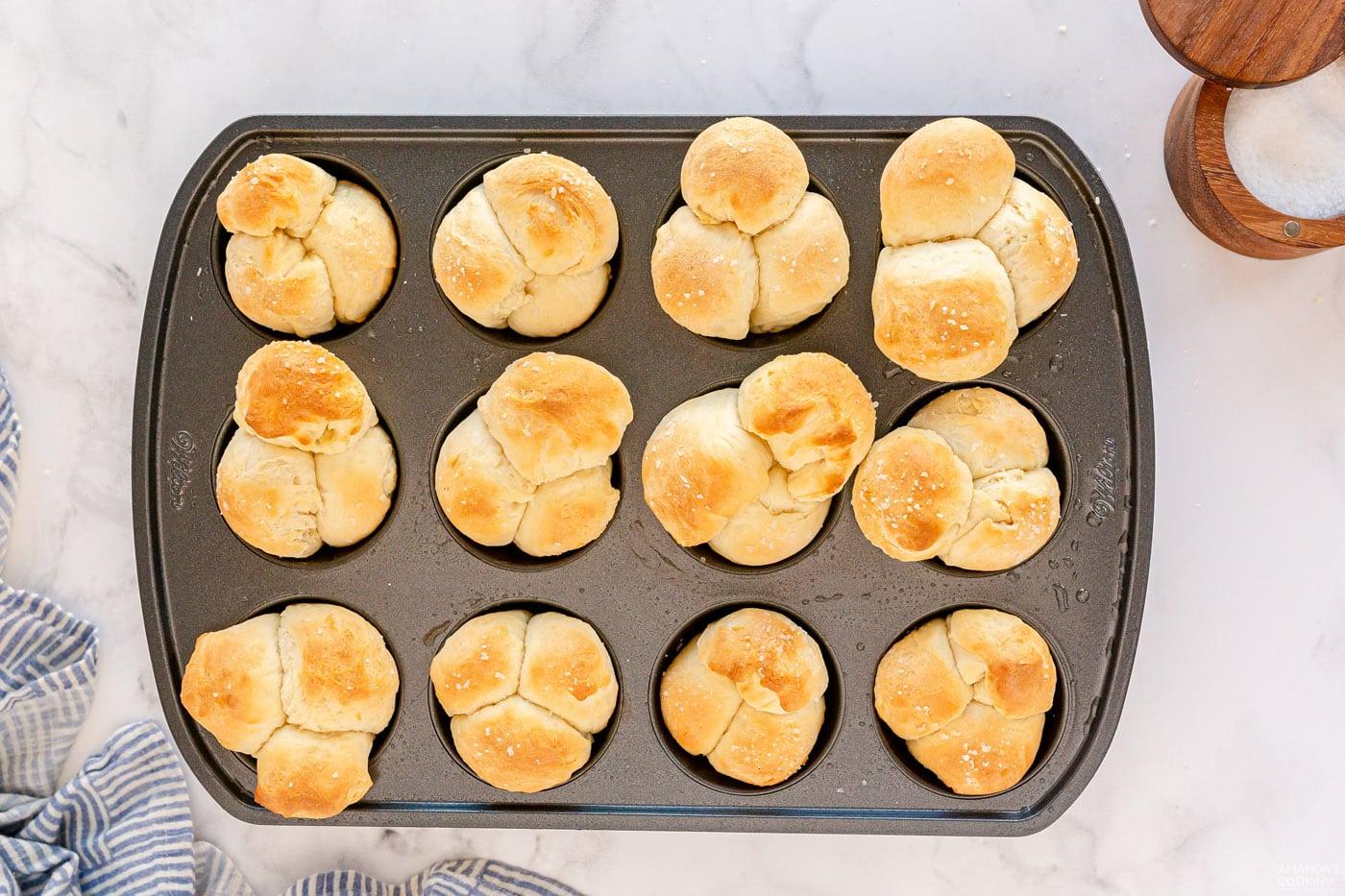 golden brown dinner rolls in pan