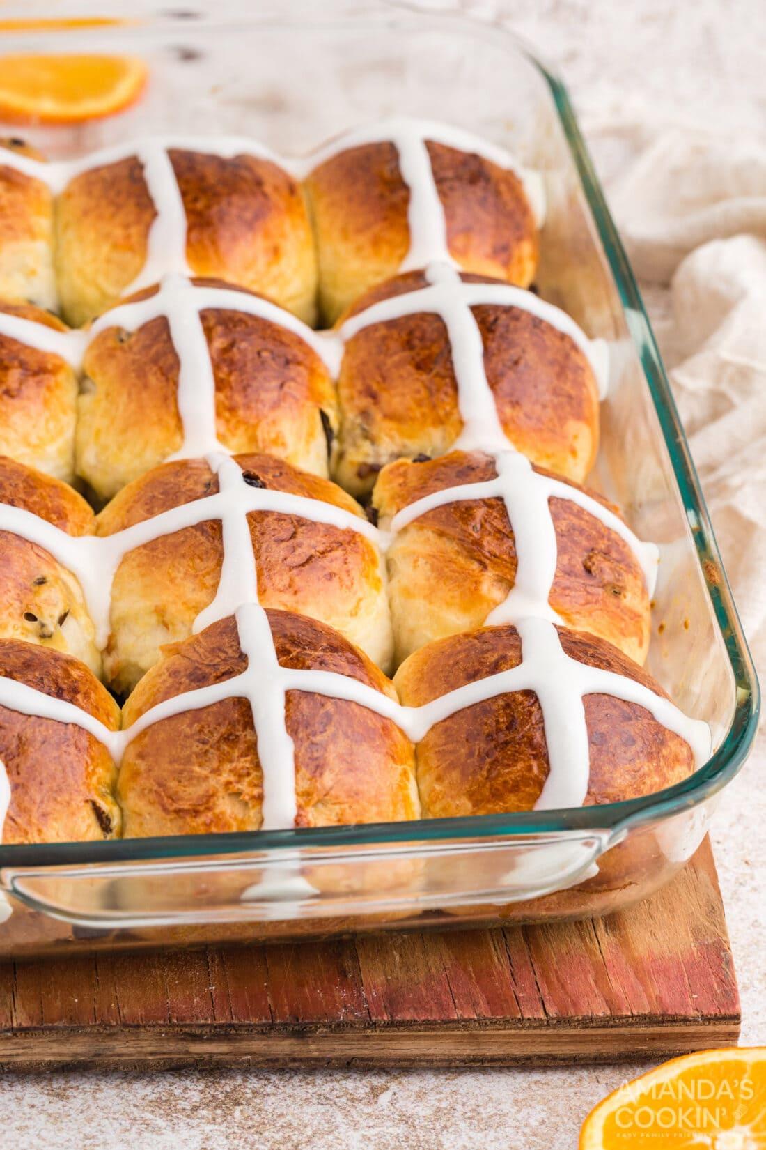 a glass pan of Hot Cross Buns