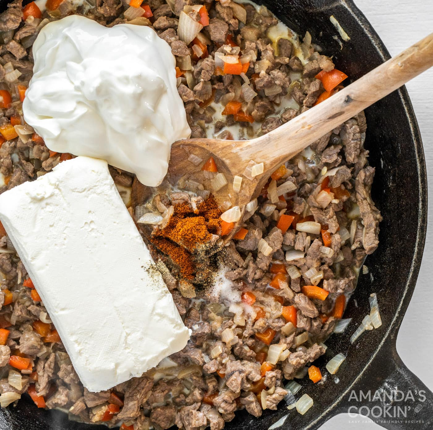 sour cream and cream cheese added to meat mixture in a skillet