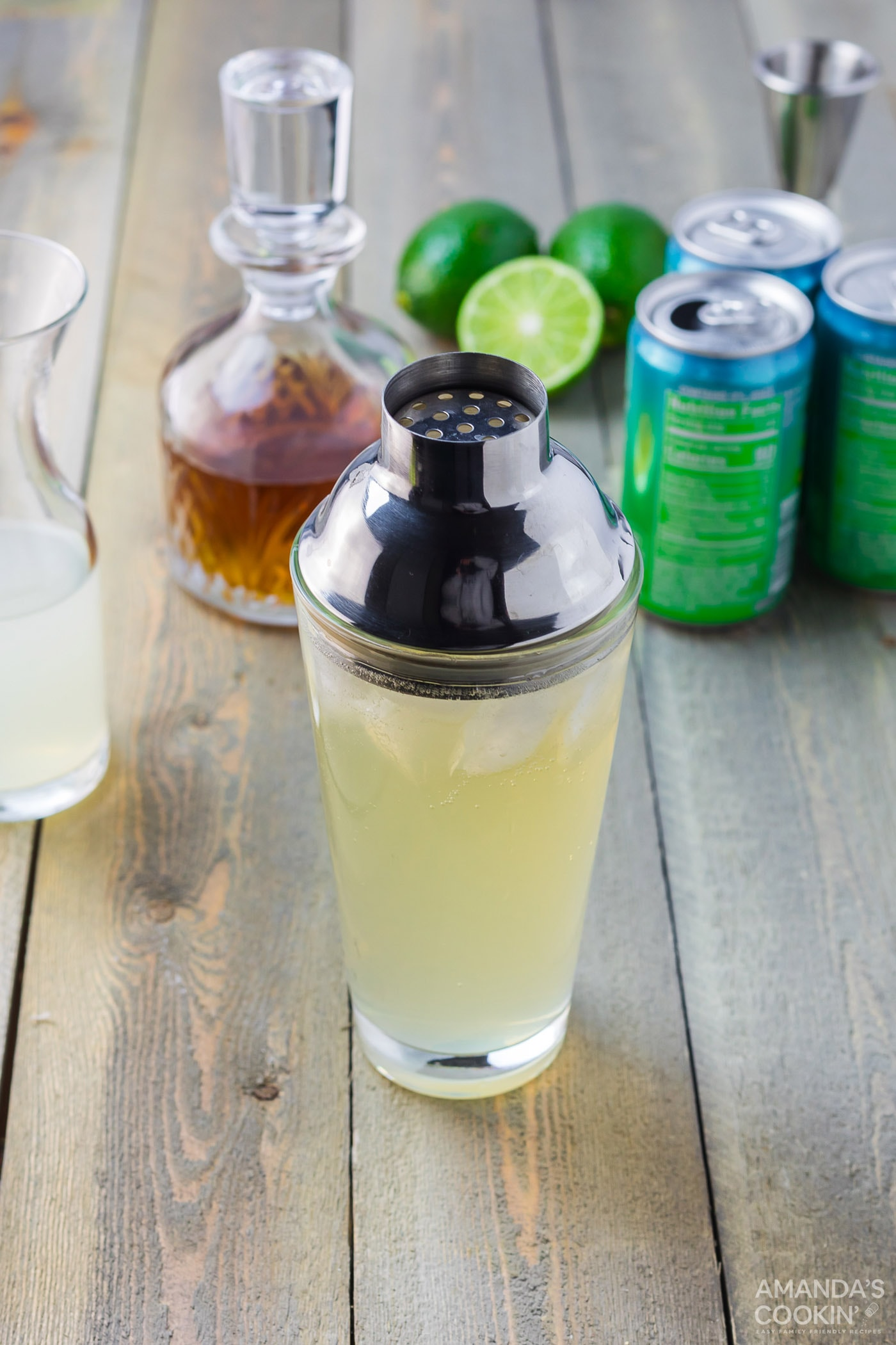 spiked limeade with cocktail shaker lid on glass