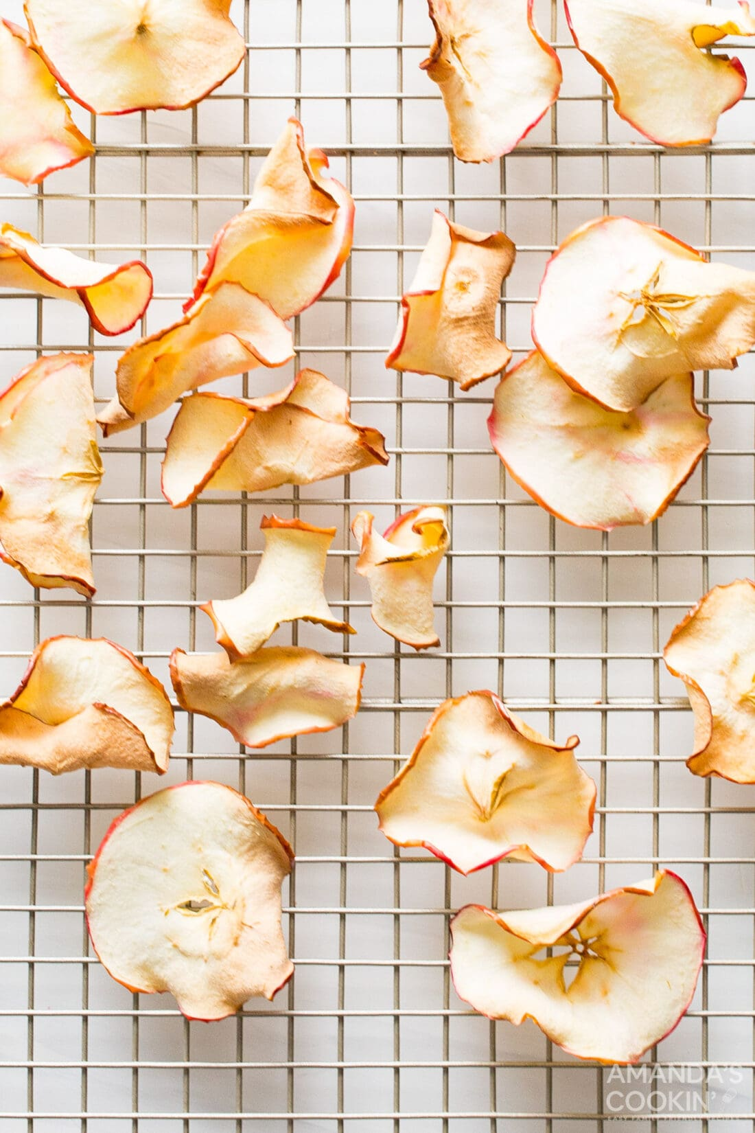 air fryer apple chips on a wire rack