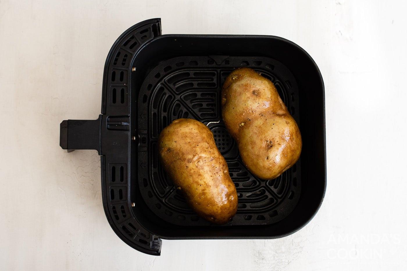 russet potatoes in an air fryer basket