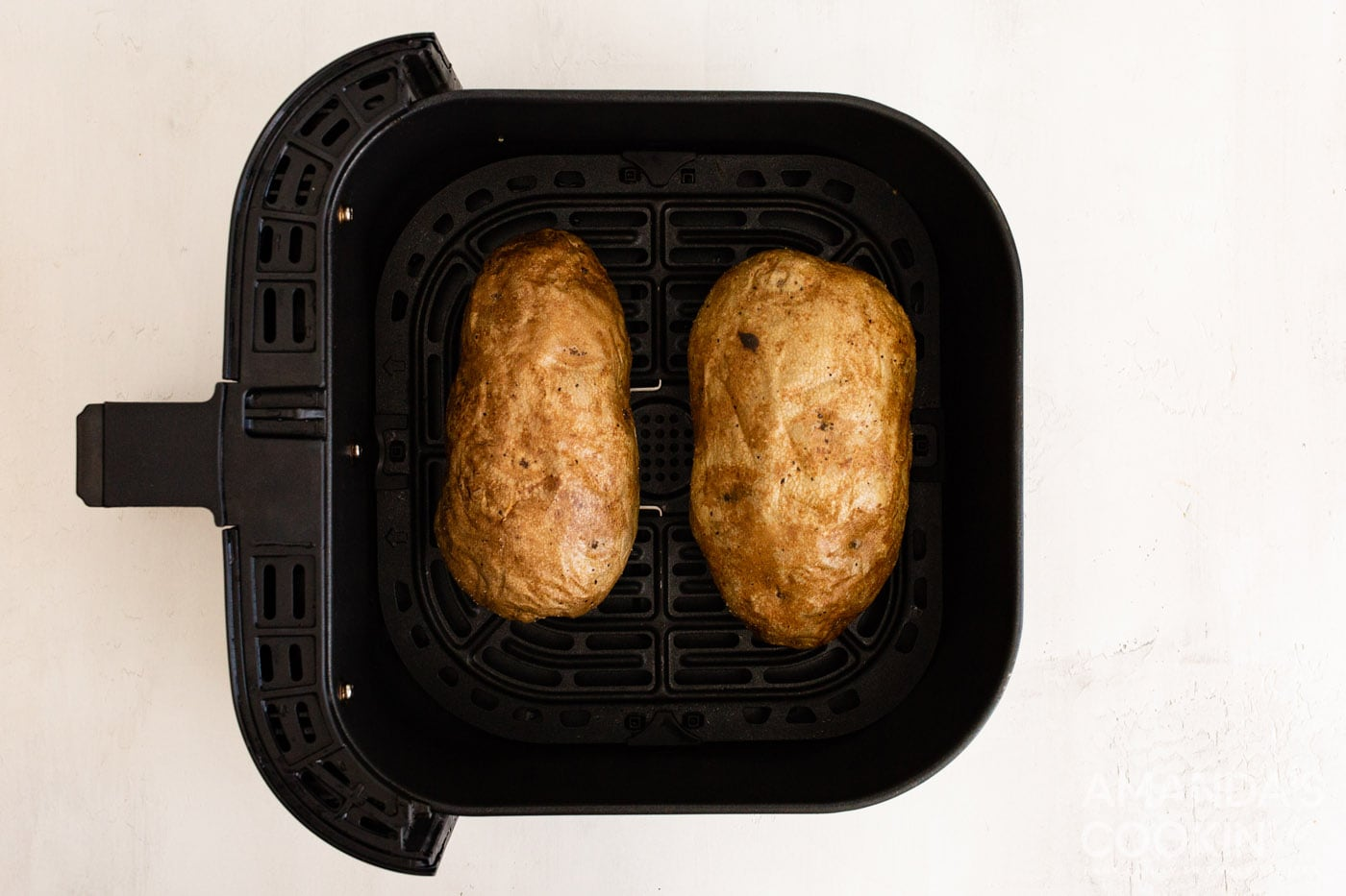 cooked russet potatoes in air fryer basket