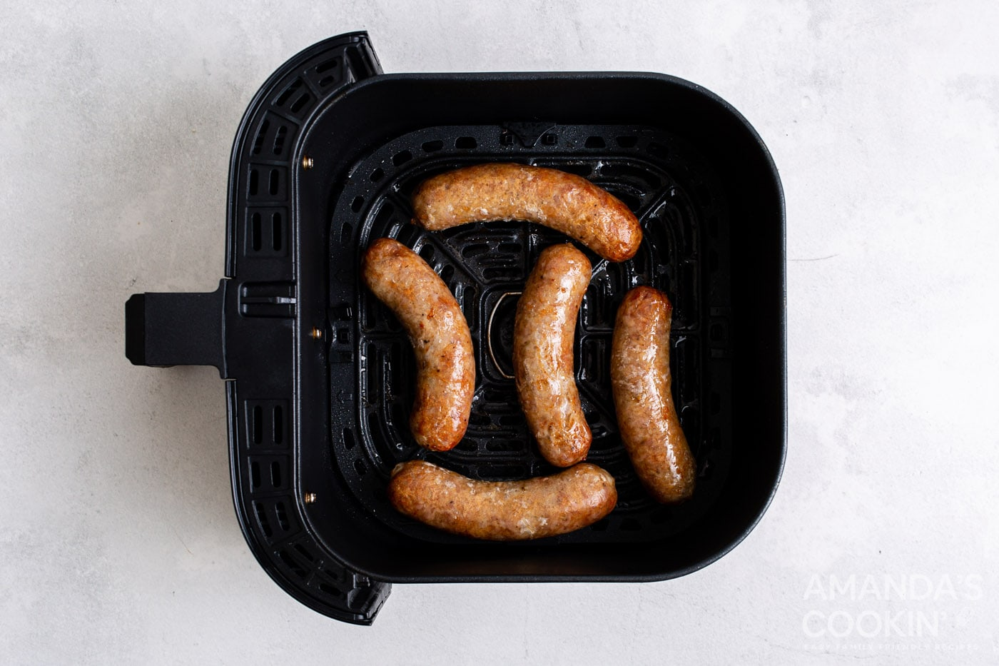 cooked bratwurst in an air fryer