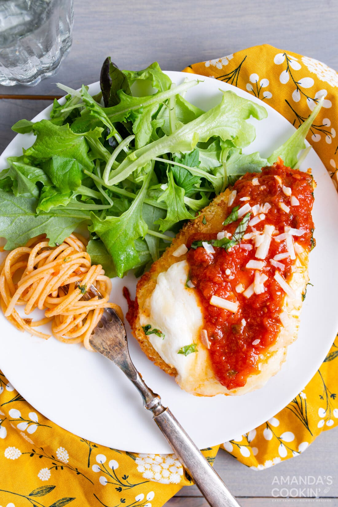air fryer chicken parm on a plate with salad