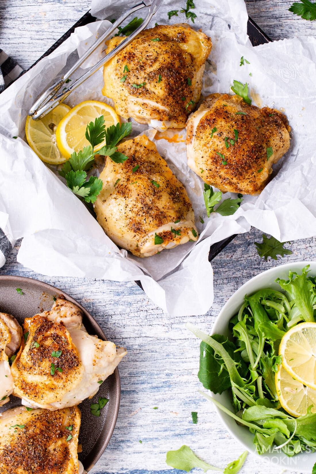 air fryer chicken thighs in a square pan with salad