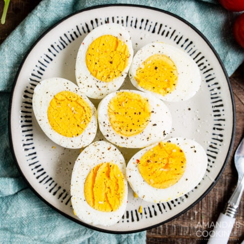 halved air fryer hard boiled eggs on a plate