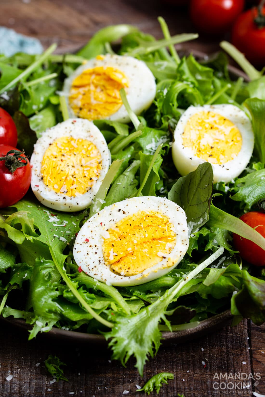 sliced hard boiled eggs on a salad