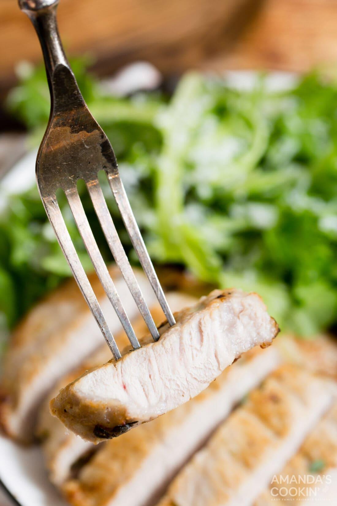 sliced pork chop on a fork