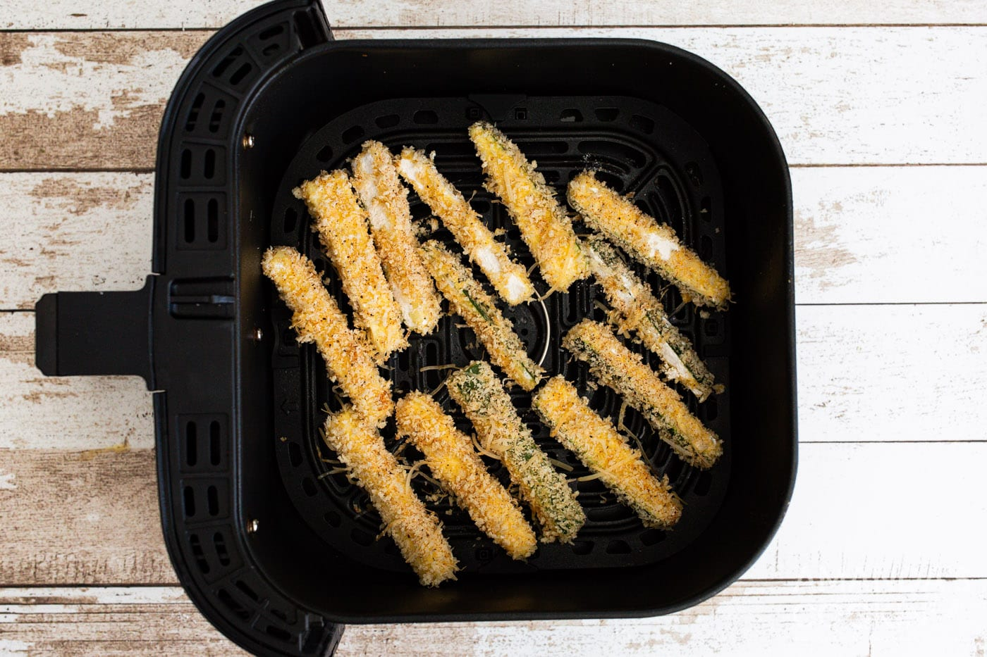 zucchini fries in air fryer basket
