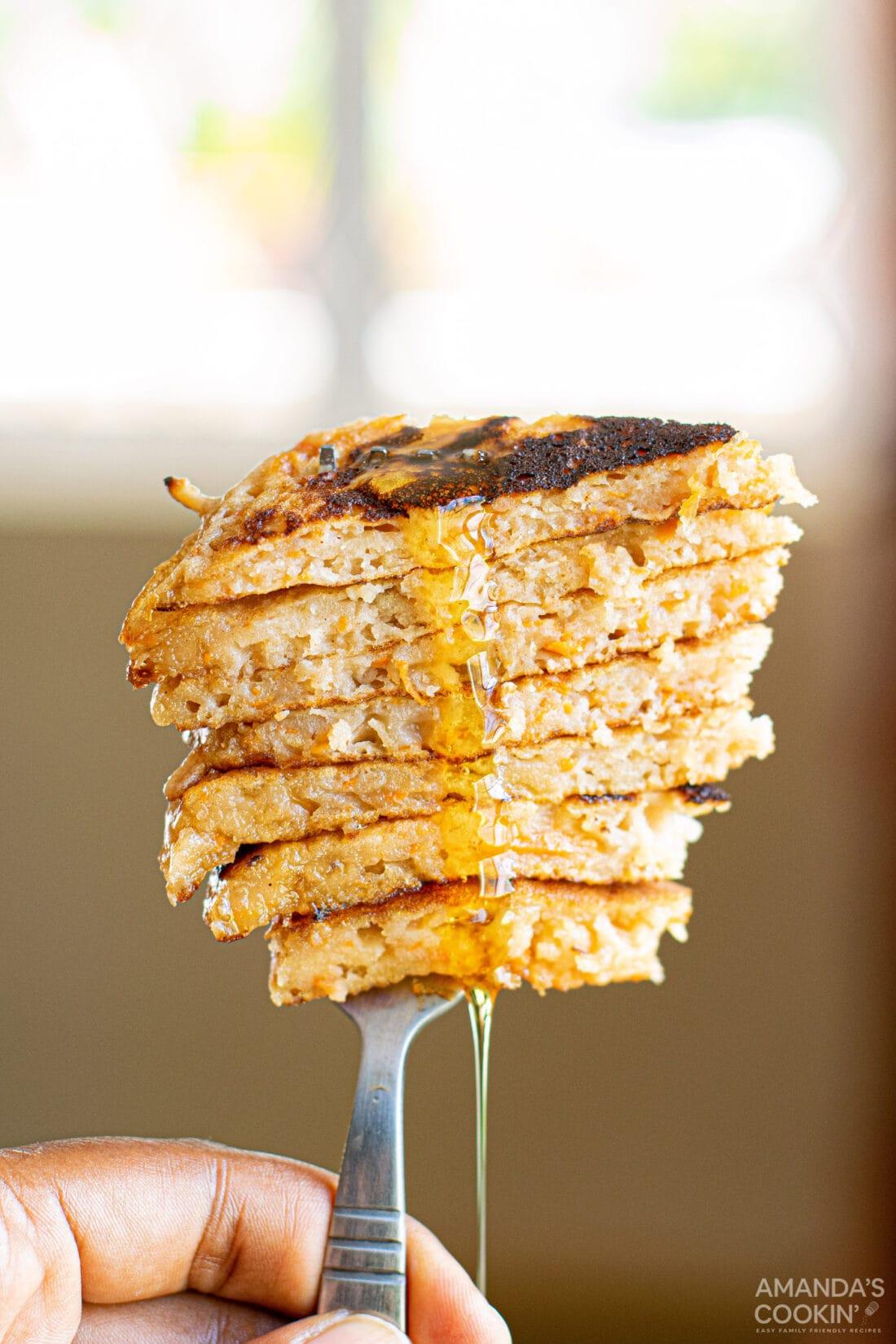 sliced carrot cake pancakes on a fork