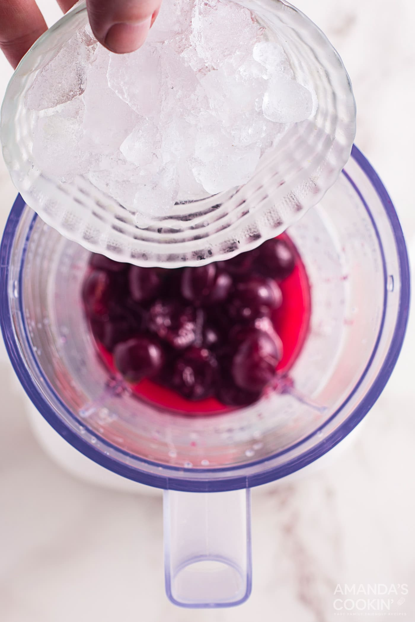 cherries and sparkling water in blender
