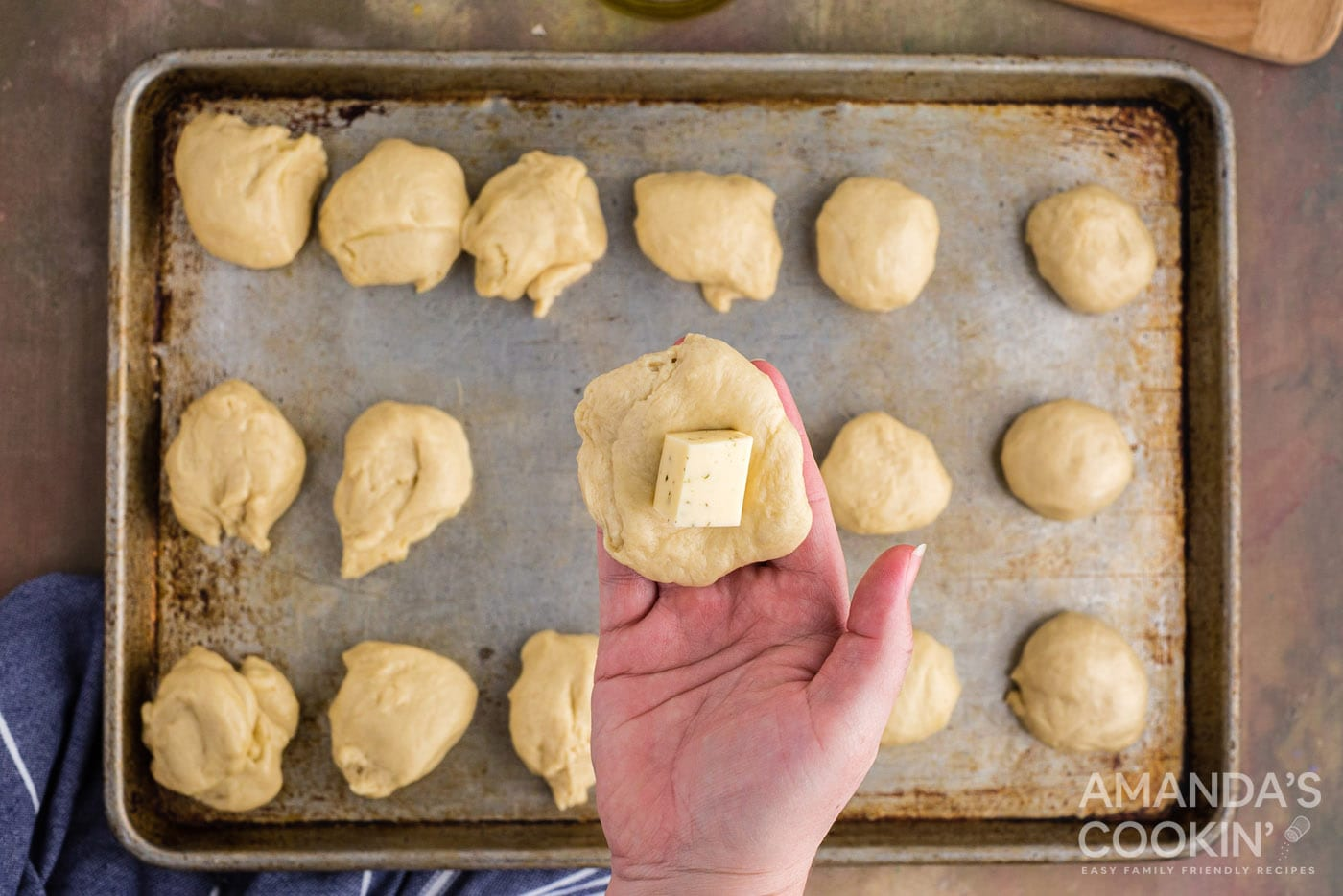 adding cheese to dough