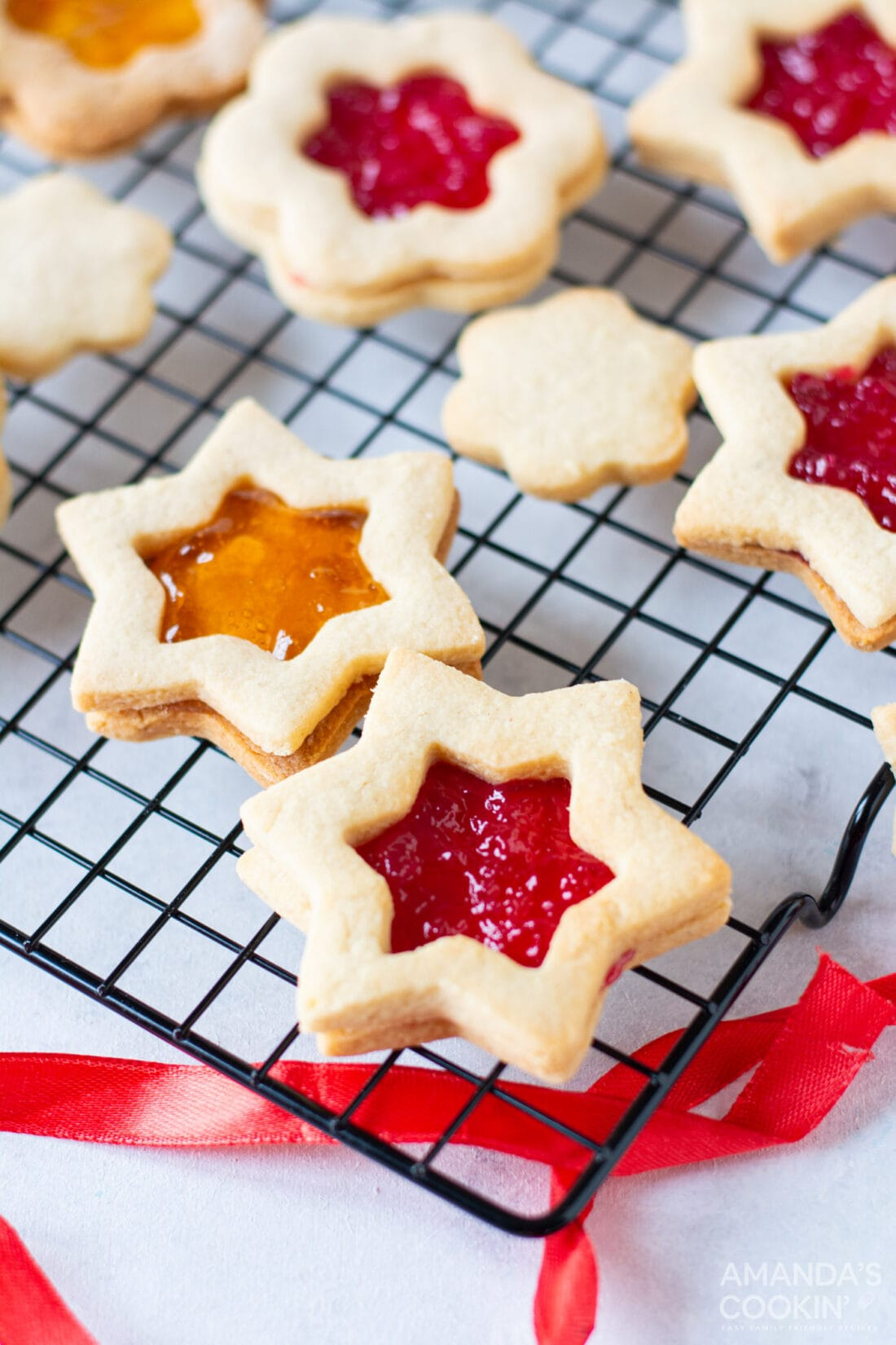 linzer cookies on a wire rack