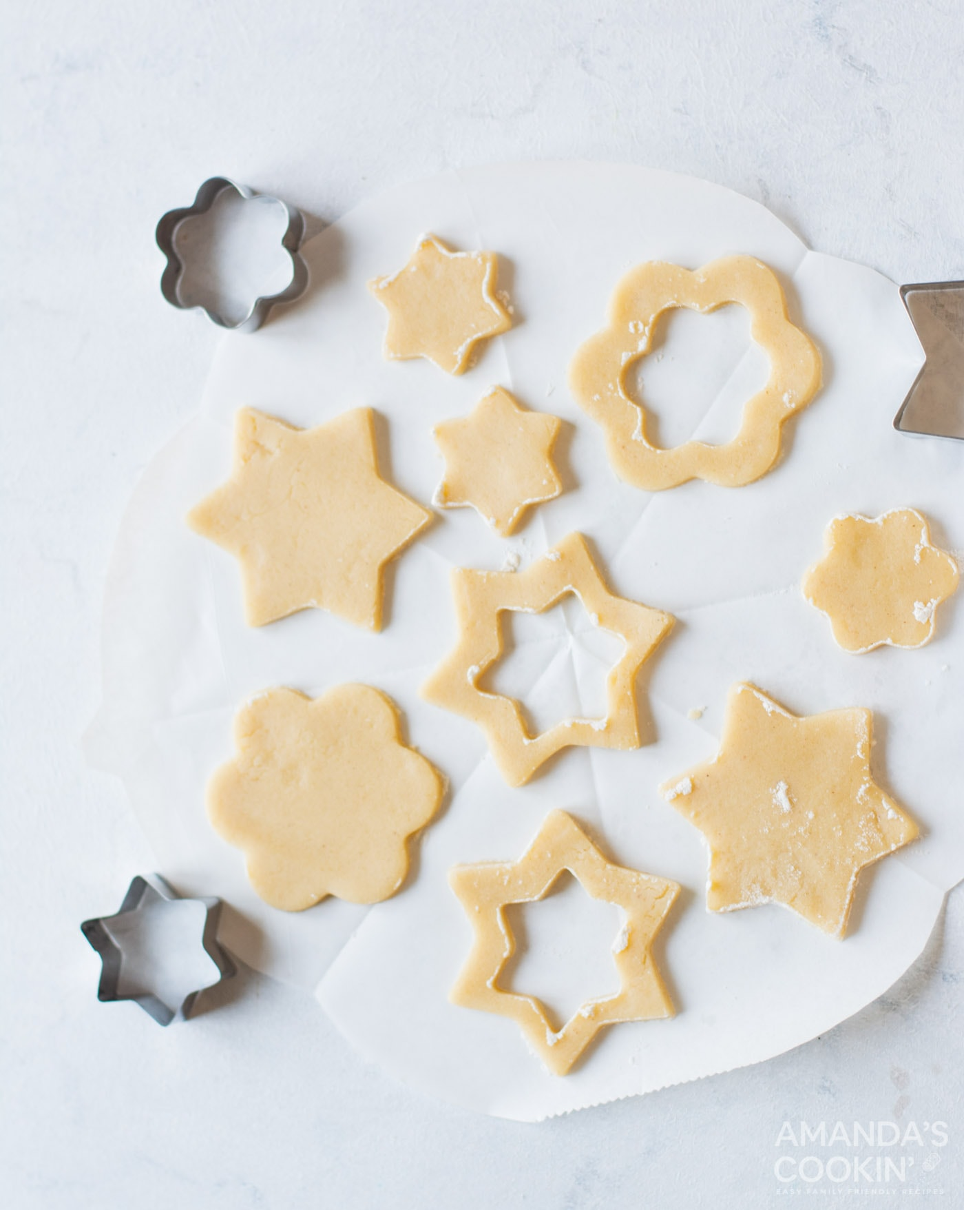 cookie dough cut by cookie cutters into shapes