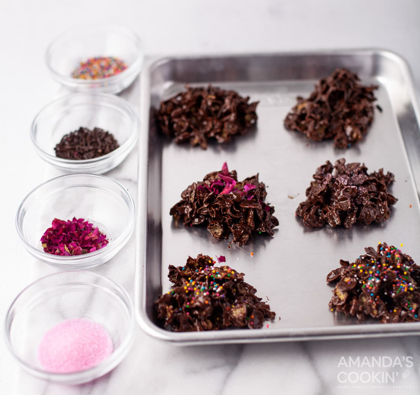 adding toppings to chocolate cornflake cookies