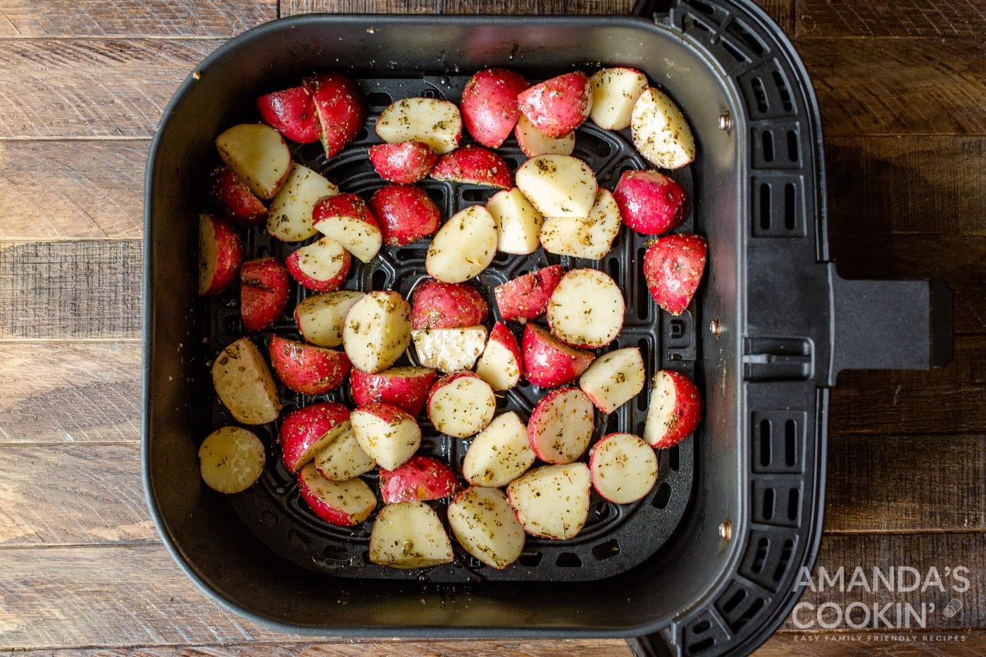 cubed potatoes in air fryer basket