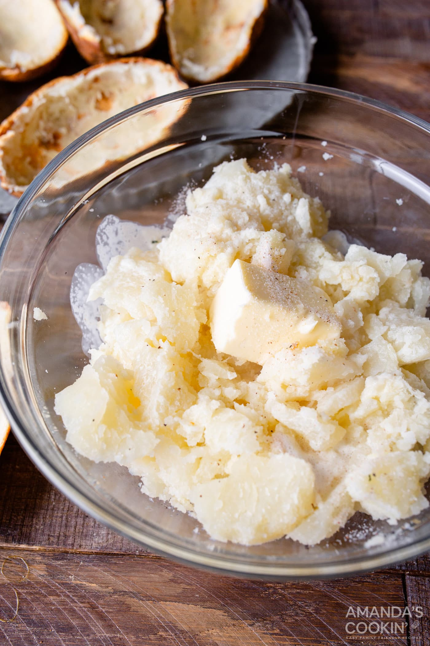 potato and butter in bowl with heavy whipping cream