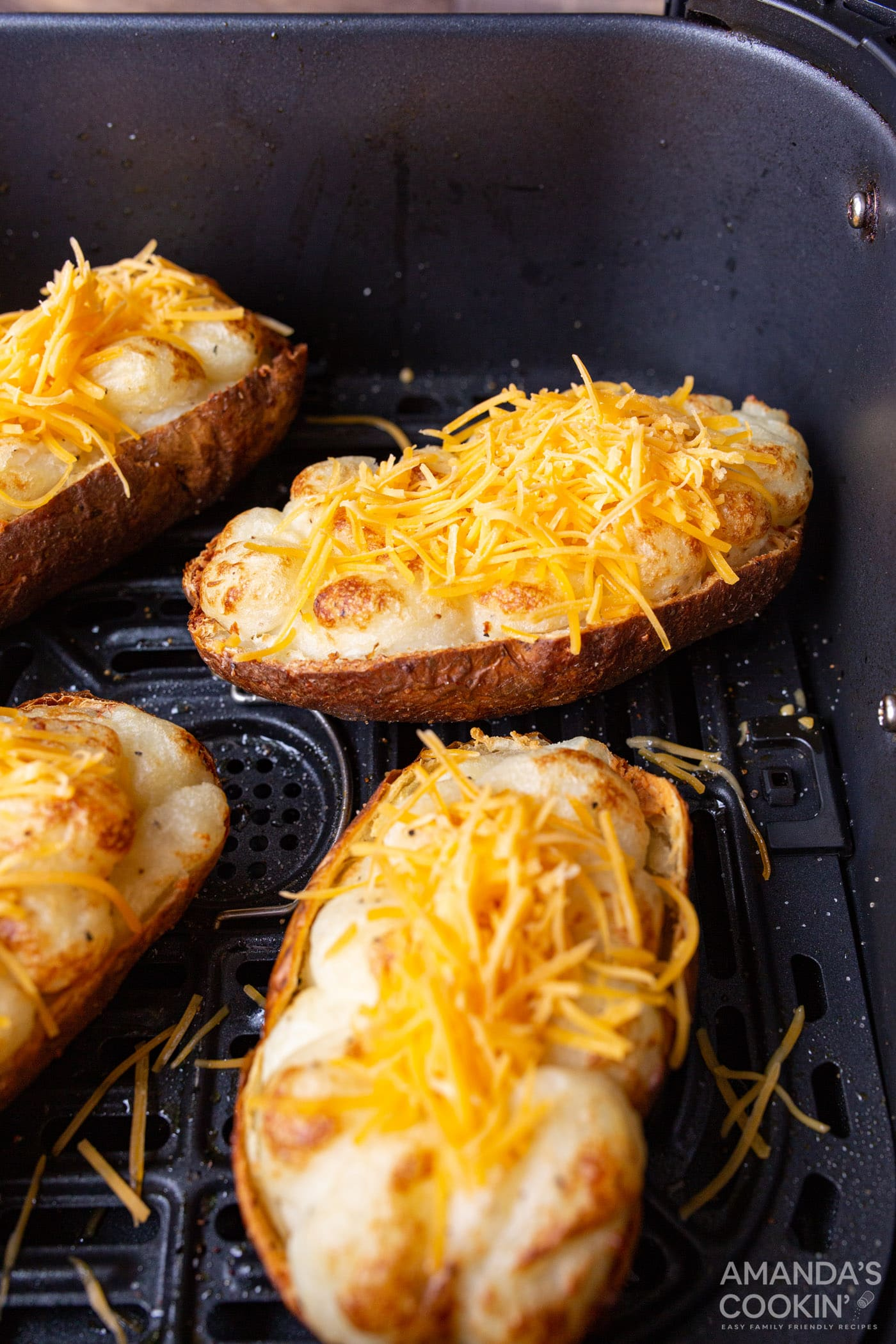 twice baked potatoes with cheese and bacon in air fryer basket